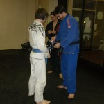 Tyler receiving his 1st stripe on his blue belt.